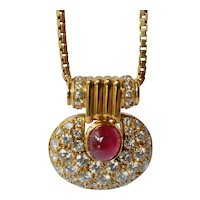 Gold  ( 18ct. ) pendant /chain diamond set (52) with  ruby, 1980c.
