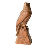 Swiss hand carved hawk perched on a rock, mid 20th. century.