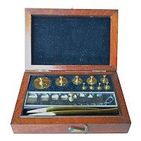 Vintage set of cased jeweller's weights.