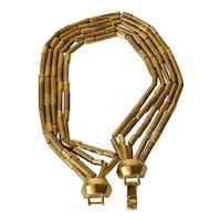 Brushed gold tone Dior necklace Tube shaped metal beads in five graduated rows, 1975c.