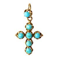 A gold ( 18 ct. ) mounted turquoise set cross,  early vintage.