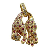 A vintage 18k gold & Gem-set Panther Pendant