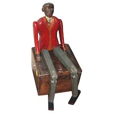 Carved and Painted Articulated Figure of a Black Man, America