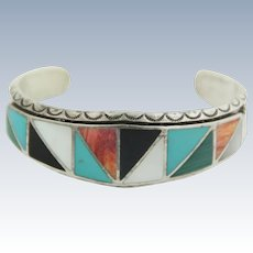Vintage Sterling Silver Carved Bangle with Colored Stone Inlays