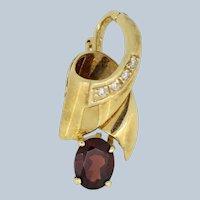 14k Yellow Gold Ribbon Swirl Diamond Pendant with Oval Garnet