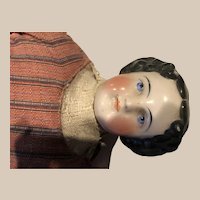 Pretty, substantial,  22 inch china doll with cloth body