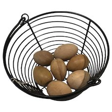 Wooden eggs in an egg basket with felt duck and chick