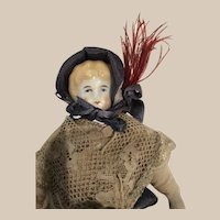 China Doll with feathered bonnet