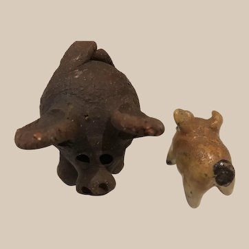 Two small Pottery Pigs