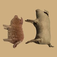 Two decorative pigs, one piggy is bristle and one is leather