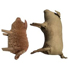 Two decorative pigs