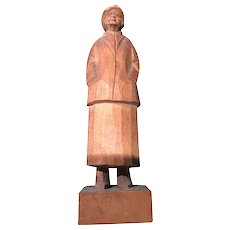 The Simple Carved Wooden Seaman in Rain Hat