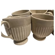 Eight Edme Demitasse cups and plates