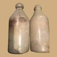 Two Classic Early Stone Bottles