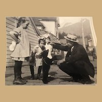 Vintage Photograph of  Children and Man with Dancing Baby Bear