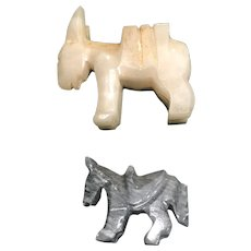 Two Stone Donkeys, one in  Cream Marble and one in Gray Marble