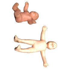 Two Plastic Crib Babies that measure under Two Inches