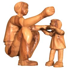 Two Small Wood Statues of Father with Child Learning to Walk