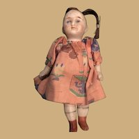 Sweet Four Inch Bisque Doll with Pink Dress