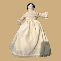 Twelve Inch China Head Doll with Two Hair bows and white dress