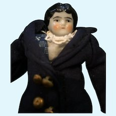 Eight inch China Head Doll in Sweet Dress and Navy Coat