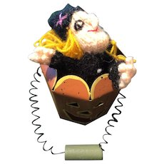 The Little Witch Puppet in the Spring Handled Tin Pumpkin