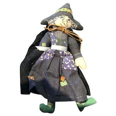 The Classic Five Inch Hallmark Halloween Witch with Striped Stockings