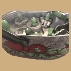 Ten vintage Tin Cookie Cutters with wood handles in a Vintage Tin