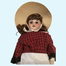 Late 19th Century Bisque Doll in Sun Dress and Sun Hat