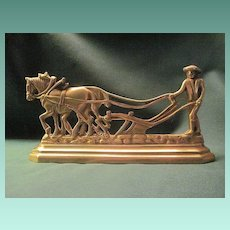 Vintage Brass Doorstop of Man and Two Horses Plowing a Field