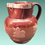 Antique Doulton Miniature Stoneware Jug With Applied Silver Collar And Relief Decoration