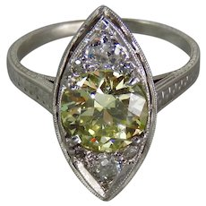 Edwardian Platinum GIA Light Fancy Yellow 1.62 Carat Old European-Cut Diamond Engagement Ring