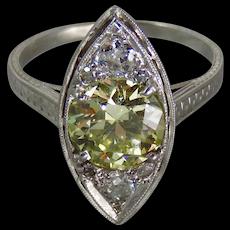 Edwardian Platinum GIA Light Fancy Yellow 1.62 Carat Old European-Cut Diamond Engagement Ring