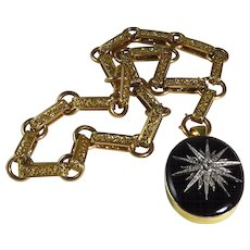Victorian 18 Karat Gold Black Onyx And Diamond Locket With Bookmark Chain