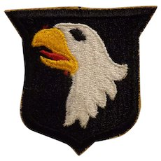 Nice Original WWII 101st Airborne Patch Type 4 with Tan Border Paratrooper
