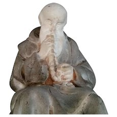 Monk Kissing His Rosary Statue