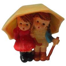 Early Plastic Figure of 2 Children Under Umbrella