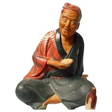 Vintage Bisque Figure of Asian Man Seated