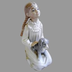 Signed and Dated NAO Figurine of Girl with Dog