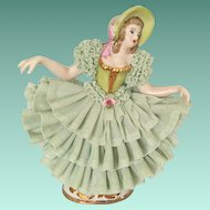 Porcelain Lace Lady in Green Figurine with Crown Mark