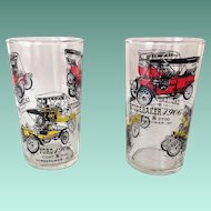 Two Vintage Automobile Glass Tumblers with Historical Information Ford, Cadillac, Buick, and Studebaker.