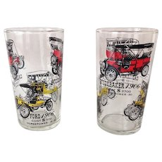 Two Vintage Automobile Glass Tumblers with Historical Information for Ford, Cadillac, Buick, and Studebaker.