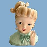 Napco C5037 Ponytail Girl Head Vase wearing Sparkling Engagement Ring on Hand
