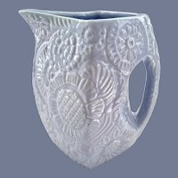 Niloak Pottery Arkansas Blue Embossed Flowers Pitcher Circa 1940