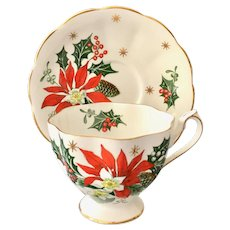 Queen Anne Noel Poinsettia Bone China Teacup and Saucer England