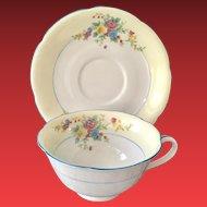 Noritake Cream-Colored Rim Blue Trim Floral Teacup and Saucer circa 1920