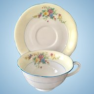 Noritake Cream-Colored Rim Blue Trim Floral Teacup and Saucer circa 1920