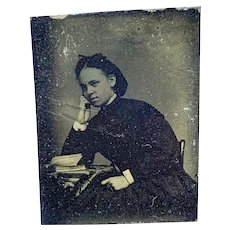 Gem tintype portrait of woman with books