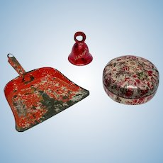 Red Christmas bell, dust pan, and box