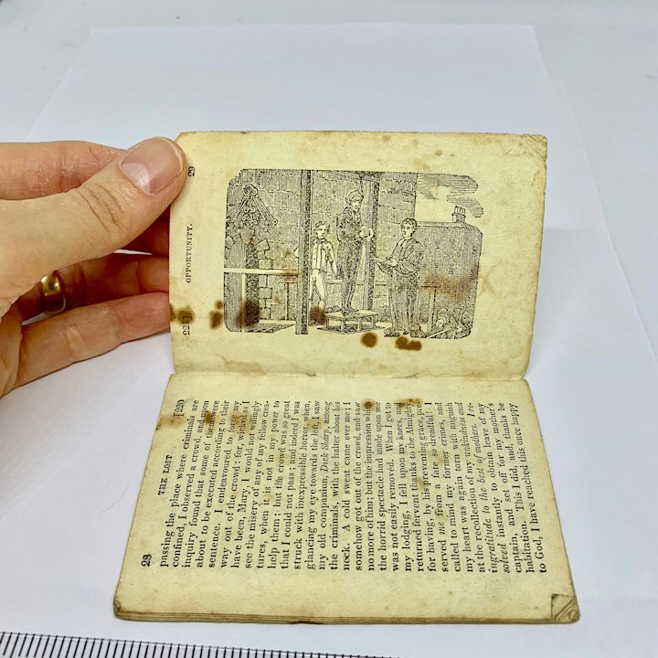 Doll size antique book